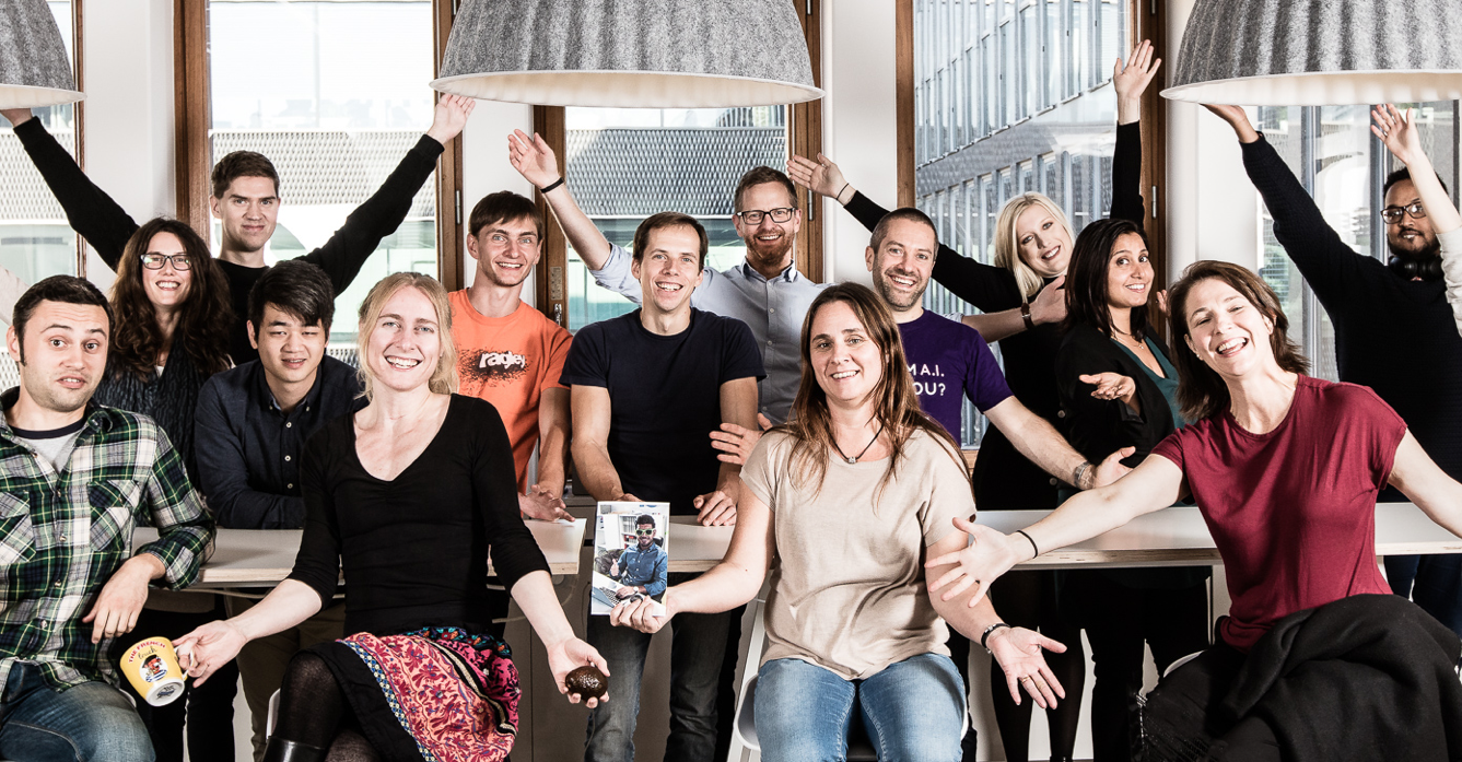 the besedo team with their hands in the air
