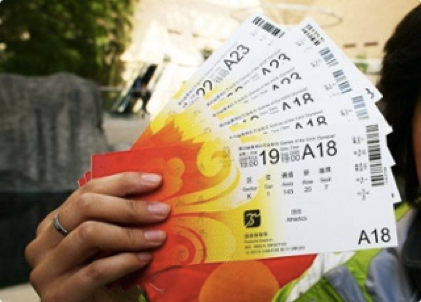 person holding event tickets